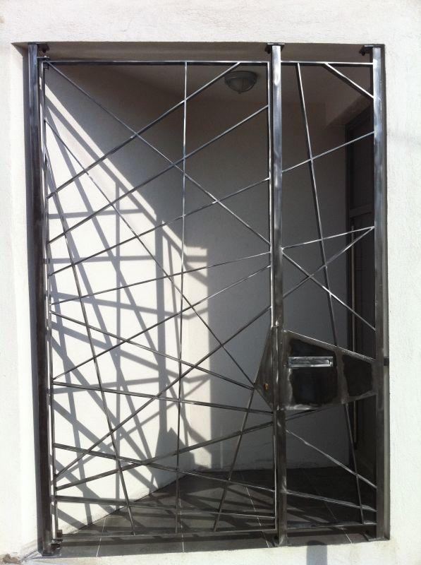 r alisation d une grille de s curit ferronnerie devey. Black Bedroom Furniture Sets. Home Design Ideas